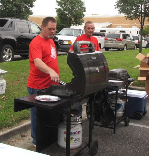 George Clapp of Coventry I and Jim of Target make hotdogs