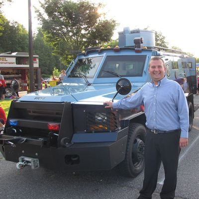 Andrew Pruski with the police armored car
